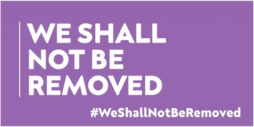 The logo of We Shall not be removed